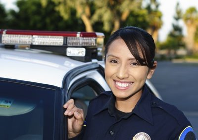 shutterstock_84538546 Smiling Cop SMALL